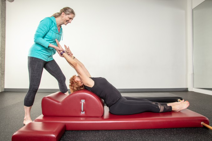 Teresa teaching Pilates to Ginny