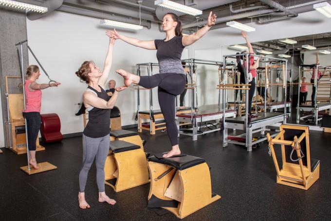 Danielle teaching Dominique in the Atlas PIlates studio
